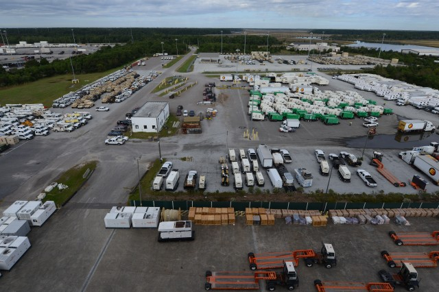Generators, vehicles, temporary living facilities and others sit waiting to be loaded onto Military Sealift Command's USNS Brittin at Joint Base Charleston Naval Weapons Station, S.C., Oct. 28, 2017. The 597th Transportation Brigade; U.S. Navy Cargo Handling Battalion 1 from Yorktown Naval Weapon Station, Virginia; the Federal Emergency Management Agency and other agencies loaded cargo onto to a humanitarian transport bound for Puerto Rico. (U.S. Air Force photo by Staff Sgt. Teresa J. Cleveland)