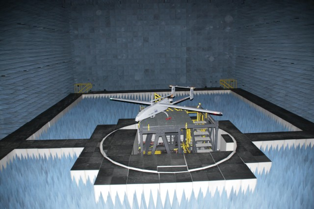 An Unmanned Aerial Vehicle is positioned inside the Army Research Laboratory's shielded anechoic chamber located at the White Sands Missile Range, New Mexico. Pseudolite prototype systems were tested within the anechoic chamber to better understand transmission capabilities, navigation abilities, interference thresholds, and overall performance. The chamber is the Army's largest anechoic chamber providing an ideal work place for applied research, development, test, evaluation, and experimentation.  White Sands Missile Range is DoD's largest fully-instrumented, open air range, provides America's Armed Forces, allies, partners, and defense technology innovators with the world's premiere research, development, test, evaluation, experimentation, and training facilities to ensure our nation's defense readiness.""