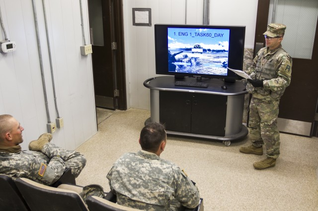 Staff Sgt. Richard Mills, an observer coach/trainer assigned to 1-410th Brigade Engineer Battalion, 4th Cavalry Multi-Functional Training Brigade, First Army Division East, leads an after-action review with a Stryker M1135 Nuclear, Biological and Chemical Reconnaissance Vehicle crew during a gunnery at Fort Hood, Texas, Oct. 28, 2017. The crew, assigned to the Army Reserve's 300th Chemical Company out of Morgantown, W. Va., conducted protection missions in their Stryker and trained on their vehicles weapons systems.