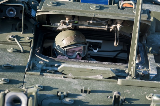 A Soldier assigned to the Army Reserve's 300th Chemical Company out of Morgantown, W. Va., surveys the area through the driver's hatch of a Stryker M1135 Nuclear, Biological and Chemical Reconnaissance Vehicle during a gunnery at Fort Hood, Texas, Oct. 28, 2017. The gunnery gave the troops the opportunity to get required training on their weapons systems.