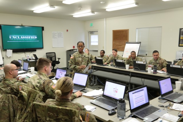 Sgt. Maj. Nicole Reddick, director for the Master Leader Course (nonresident) at USASMA briefs a class of Basic Leader Course students about the presenting information to groups between presentations at the Sgt. 1st Class Christopher R. Brevard NCO Academy here Oct. 30, 2017. Reddick facilitated the first iteration of validation of a new BLC curriculum, the first change of its kind in more than 40 years.