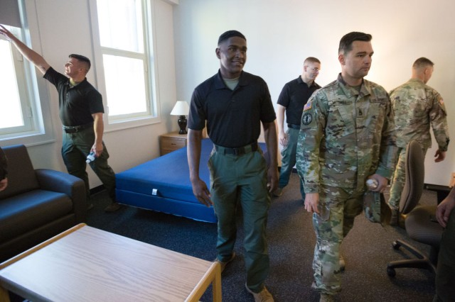 Soldiers tour Joint Base Myer-Henderson Hall's Barracks Building 247 after a ribbon-cutting ceremony Oct. 31.