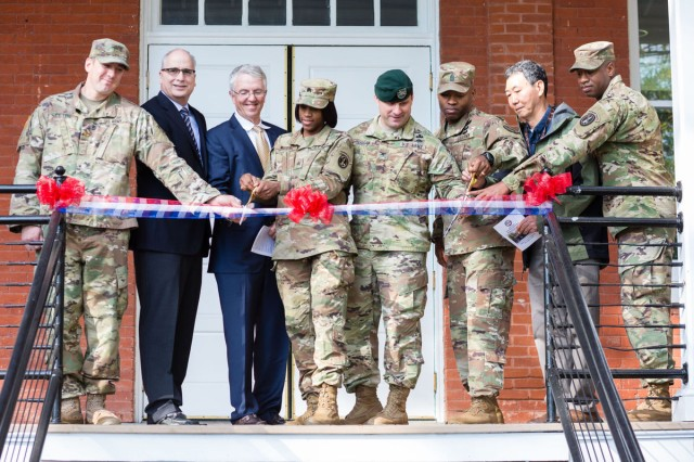 From left, Army Maj. Andrew A Petrie, John F. Treseler, Peter Grimberg, Army Sgt. Tahjanae R. Watkins, Joint Base Myer-Henderson Hall Commander Col. Patrick M. Duggan, JBM-HH Command Sgt. Maj. Stephen M. Harris, JBM-HH Public Works Director Bonsok L. Escobar and Army Staff Sgt. Jonathan Benton participate in a ribbon-cutting ceremony at Barrack's Building 247 Oct. 31.