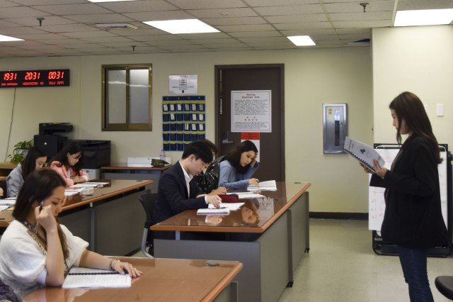 Intern Coordinater Choi, Jeong-a briefs a group of 30 fall-session interns on the guidelines and expectations of internship at U.S. Army Garrison Daegu.