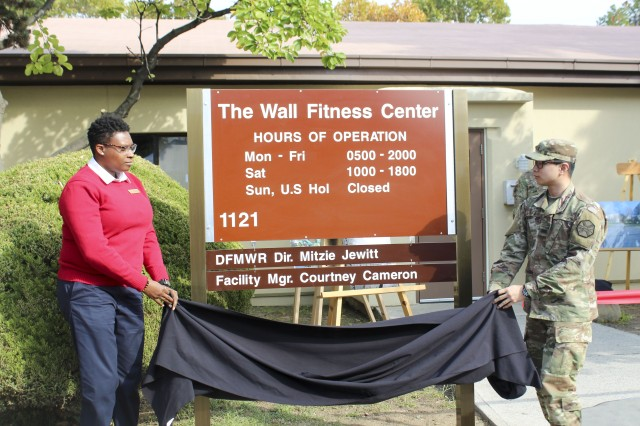 Five Vietnam veterans and USAG Daegu personnel stand in front of the The Wall Fitness Center for the facility renaming ceremony, Nov. 2, 2017, in front of the Camp Henry The Wall fitness center.
