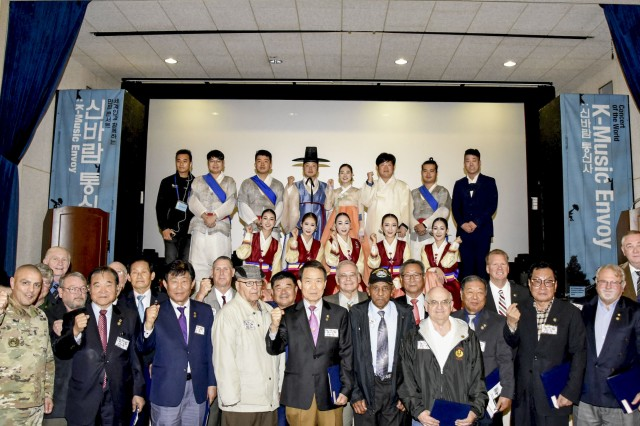 After the pinning ceremony, Vietnam Veterans from the U.S. and Korean K-Music Envoy team and USAG Daegu Command Group take a group photo as a respect for the dedicated service and representation of U.S. and Korea Alliance, Nov. 3, at Camp Henry Theater.