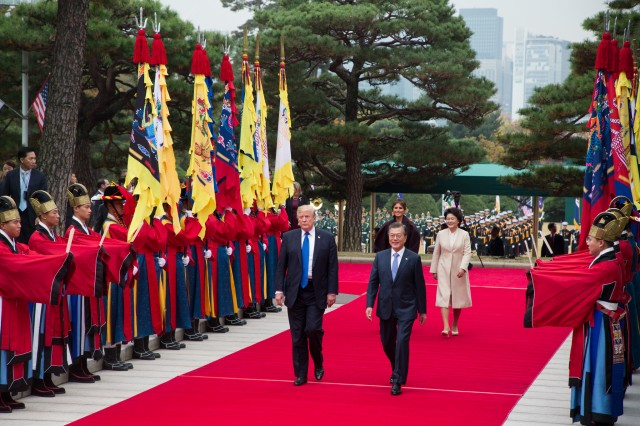 President Donald J. Trump and South Korean President Moon Jae-in, accompanied by their wives, arrive for talks at the Blue House in Seoul, South Korea, Nov. 7, 2017.
