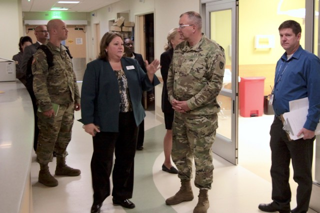 Michelle Werner (front left), associate director of the John D. Dingell Veterans Affairs Medical Center, explains the layout of a newly constructed emergency room to Maj. Gen. Clark LeMasters, commanding general of U.S. Army Tank-automotive and Armaments Command, during a tour with VAMC physicians, administrators and TACOM personnel, Nov. 3, 2017.