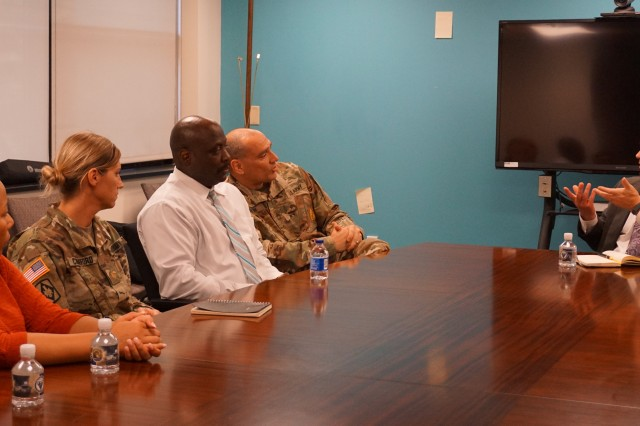 Deputy to the Commanding General (DCG) Larry M. Muzzelo, U.S. Army Communications-Electronics Command (CECOM), Aberdeen Proving Ground (APG), Maryland, leads a discussion with a diverse group of members of the APG SHARP Resource Center during his recent visit to the new facility.