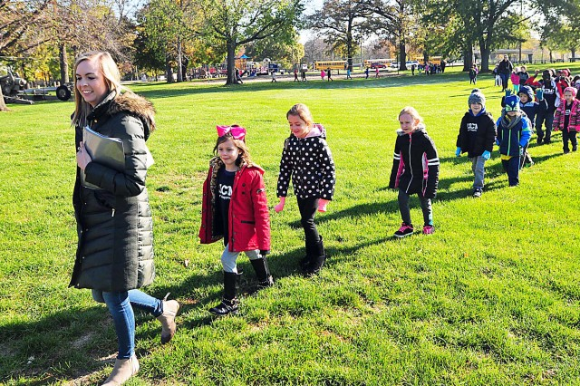 First graders from the Rock Island Center for Math and Science led by their teacher arrive at Memorial Field at Rock Island Arsenal, Ill., Nov. 8, as part of a field trip in conjunction with Veterans Day. (Photo by Jon Micheal Connor, ASC Public Affairs)