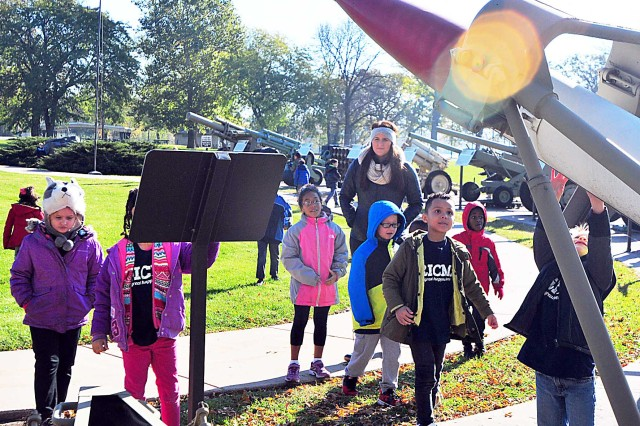 First-grade students from the Rock Island Center for Math and Science check out weaponry at Memorial Field Nov. 8. (Photo by Jon Micheal Connor, ASC Public Affairs)