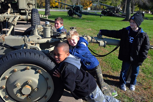 Young students try to push this Army weaponry at Memorial Field Nov. 8. (Photo by Jon Micheal Connor, ASC Public Affairs)