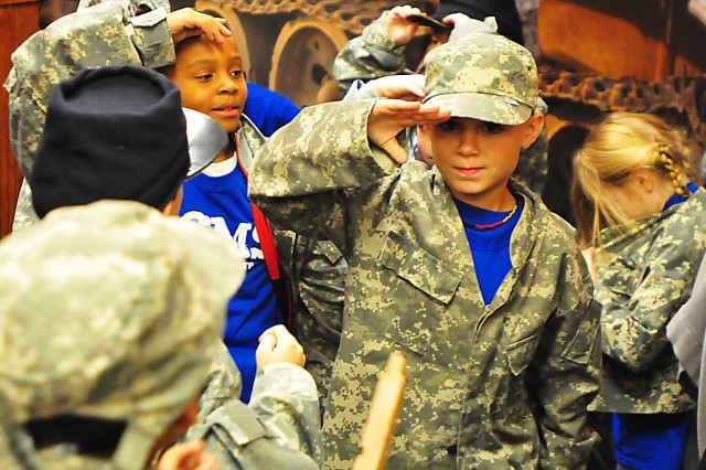 Second-grade students from the Rock Island Center for Math and Science don Army uniforms at the arsenal's museum Nov. 8. (Photo by Jon Micheal Connor, ASC Public Affairs)