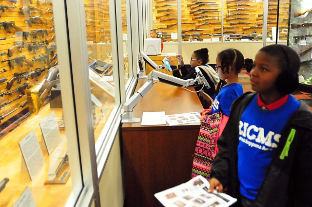 Second-grade students from the Rock Island Center for Math and Science learn about the rifles displayed at the museum Nov. 8. (Photo by Jon Micheal Connor, ASC Public Affairs)