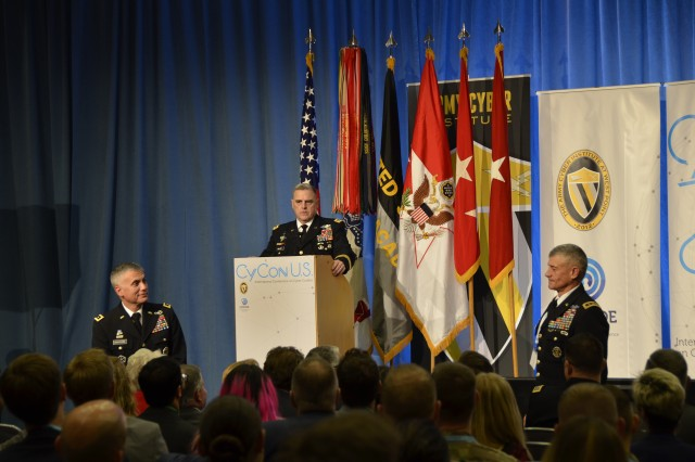 Army Chief of Staff Gen. Mark A. Milley responds to an audience member's question by recognizing Lt. Gen. Paul M. Nakasone, commander of Army Cyber Command (left) and Lt. Gen. Robert L. Caslen Jr., superintendent of the U.S. Military Academy (right), as examples of leaders helping to move the Army into the future, during his remarks at the International Conference on Cyber Conflict U.S. (CyCon U.S.) in Washington, D.C., Nov. 7, 2017. The three-day event, designed to promote multidisciplinary cyber initiatives and further research and cooperation on cyber threats and opportunities, is a collaborative effort between the Army Cyber Institute at the U.S. Military Academy and the NATO Cooperative Cyber Defence Centre of Excellence.