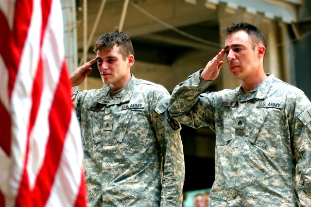 Sgt. Jon Beauvais, left, and Sgt. Brian Nicoson, both assigned to A Company, 2nd Battalion, 14th Infantry Regiment, pay their respects to fallen comrade Sgt. Steven Packer during a memorial ceremony May 26, 2007, at Patrol Base Dragon, Iraq. Fifty-four Soldiers were killed and 267 wounded during 2nd Brigade Combat Team's 15-month-long deployment to Iraq from August 2006- November 2007.