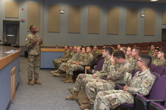 Lt. Col. John D. Clemons, with Headquarters and Headquarters Battalion at Fort Drum, speaks with 10th Mountain Division (LI) Soldiers about the Security Force Assistance Brigade during a briefing Oct. 20 at the Multipurpose Auditorium. SFAB is an organization dedicated to training and advising partner nations' military forces. The goal of the briefing was to inform and recruit Soldiers for the SFAB.