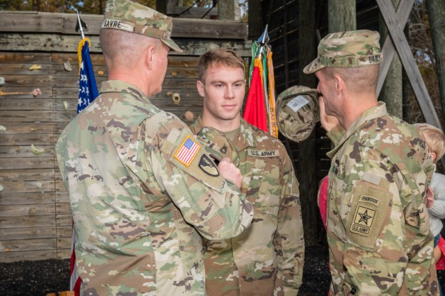 Maj. Gen. Kent Savre, Maneuver Support Center of Excellence and Fort Leonard Wood commanding general, and Sergeant Major of the Army Daniel Dailey, participate in the promotion of Sgt. 1st Class Ryan McCarthy Nov. 2.