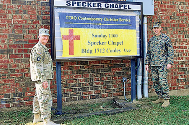 From left, Chaplain (Capt.) Luis Anda and Navy Chaplain (Lt.) Jeremy Bennett pose in front of the sign at Specker Chapel. The ministry team will begin leading a contemporary worship service Sunday at the facility.