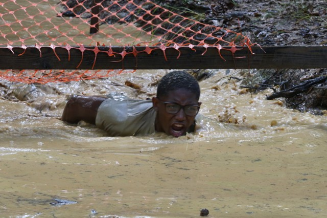 A Cadet from North Paulding High School in Dallas, Georgia, comes up for air after low crawling through an obstacle on the Cross-Country Rescue Course during the JROTC's National Raider Championships held at the Gerald Lawhorn Boy Scout Camp in Molena, Georgia, Nov. 4-5.