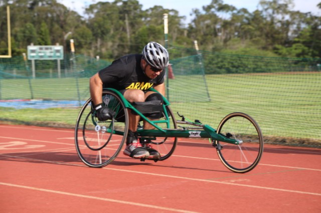 Maj. Rolando Reyes, assigned to the Tripler Army Medical Center Warrior Transition Battalion competes in the wheelchair racing track event on Nov. 7 during the Pacific Regional Trials 2017 wounded warrior sports competition at Stoneman Field, Schofield Barracks, Hawaii.