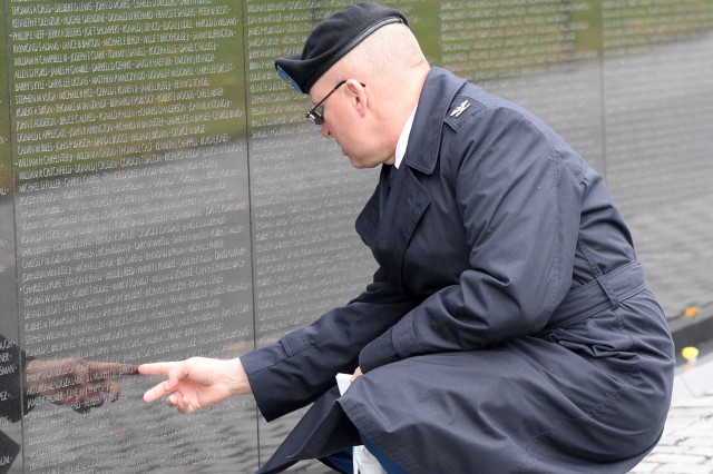 "Col. John Dowling, assigned to the Military Postal Agency in Crystal City, Virginia, takes a moment to find a name before participating in the in the ""Reading of the Names"" event. In honor of their sacrifice, a group of volunteers paid tribute to those lost or missing in combat, as they collectively announce the names of all 58,318 service members inscribed on ""The Wall."""