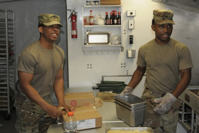 (left) Leron Howard a food service specialist with headquarters support company, headquarters and headquarters battalion, I Corps, and Pfc. Willie Mills, a food service specialist with headquarters support company, headquarters and headquarters battalion, 25th Infantry Division begin preparation for a meal during a Warfighter exercise (WFX) 18-2 at Camp Hovey, South Korea, on Nov. 8, 2017. Soldiers during WFX 18-2 have to start preparing meals hours in advance due to working in a field environment.