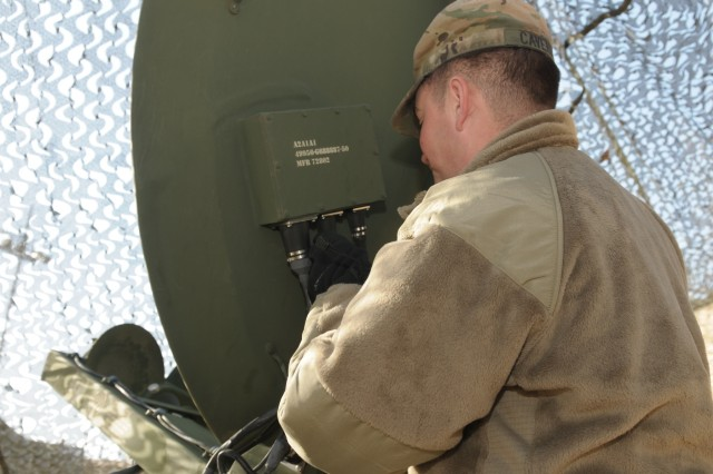 Pfc. Matthew Cavender, a multi-channel transmission systems operator maintainer,  from I Corps Signal Intelligence Sustainment Company, ensures a satellite has a clear connection during a Warfighter exercise (WFX) 18-2 at Camp Hovey, South Korea on Nov. 11, 2017. Communication system infrastructure is the backbone of all communication during training and real world operations.
