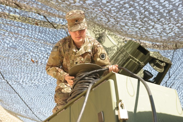 Spc. Phoebe Moreo, a multi-channel transmission systems operator maintainer,  from I Corps Signal Intelligence Sustainment Company, preforms preventative checks and maintenance on a satellite communication system to ensure it is running correctly during Warfighter exercise (WFX) 18-2 at Camp Hovey, South Korea on Nov. 11, 2017. Personal communications and the entire communication system infrastructure such as these are crucial to the coordination of Troops and overall success of the mission.