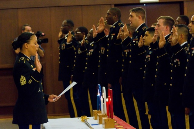Command Sgt. Maj. Carla M. Hill, 39th Transportation Battalion, leads the Knights Brigade's noncommissioned officers in reciting the Charge of the Noncommissioned Officer during the NCO Induction Ceremony.