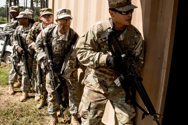 Soldiers from the 642nd Regional Support Group prepare to clear a building during an urban operations familiarization event Aug. 22, 2017, at Ft. McClellan, Ala. Soldier Lethality is one of the six priorities established by the Army Chief of Staff that will be the focus of six new Cross-Functional Teams focused on modernization and readiness.
