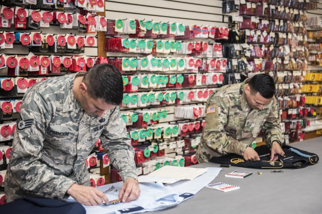 Air Force Staff Sgt. Giuseppe Francioni (left) and Army Reserve Staff Sergeant Luis Diaz (right) assemble the dress uniforms of their respective services for use during mortuary affairs operations at the Charles C. Carson Center, located at Dover Air Force Base in Dover, Del., Oct. 24, 2017. The Charles C. Carson Center is home to the Port Mortuary, which is responsible for returning all Department of Defense service members, civilians, and contractors who perish during contingency operations overseas. The 73,000 square foot facility was built in 2003 at a cost of $30 million.