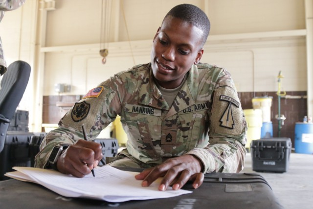Sgt. 1st Class Larhonda Hankins, a 92Y -- unit supply specialist -- with the 6th Battalion, 1st Security Force Assistance Brigade, receives a RQ-11 Raven Nov. 7 at Kelley Hill on Fort Benning, Ga., for use by 1st SFAB Soldiers in training for a slated deployment. Hankins arrived with the 1st SFAB in August and said she loves to be a part a new unit and building it from scratch. 1st SFAB is a new unit that is specially trained and built to enable combatant commanders to accomplish theater security objectives by training, advising, assisting, accompanying, and enabling allied and partnered indigenous security forces. (U.S. Army photo by Spc. Noelle E. Wiehe/ Released)
