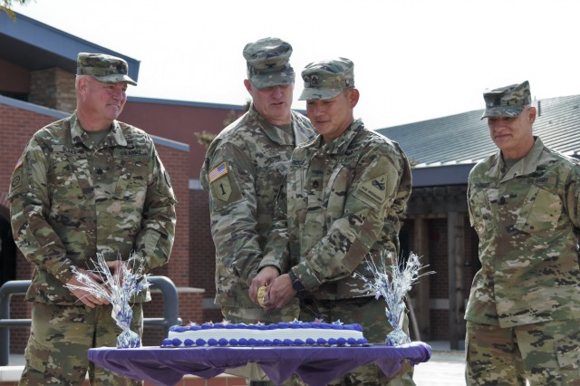 (From left) Lt. Col. Curtis Blake, commander, Fort Bliss Warrior Transition Battalion, Col. Michael Hester, chief of staff, Task Force Tank, 1st Armored Division, Staff Sgt. David Rogers, a purple heart recipient assigned to 1st Battalion, 36th Infantry Regiment, 1st Stryker Brigade Combat Team, 1st AD, and Command Sgt. Maj. Matthew Unger, command sergeant major, Fort Bliss WTB, participate in a cake cutting commemorating the beginning of Warrior Care Month at the Fort Bliss WTB, Nov. 1. Warrior Care Month is observed each November and was established in 2008 to increase awareness of programs and resources available to wounded, ill and injured service members, caregivers and families.