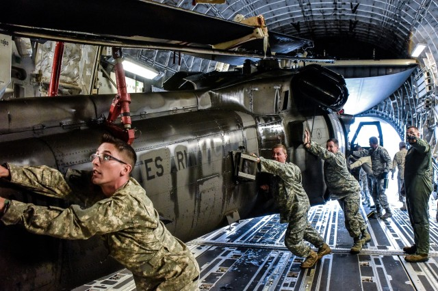 Tennessee National Guard Soldiers push a UH-60 Blackhawk into a C-17 aircraft carrier Sept. 13 at Joint Base Berry Field, Nashville, Tennessee. The Tennessee National Guard deployed to the U.S. Virgin Islands to support disaster relief efforts and provide humanitarian aid in the aftermath of Hurricane Irma.