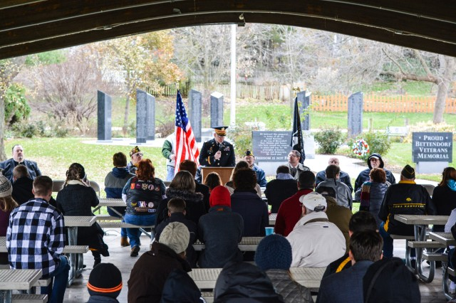 Col. Bradley Cook, inspector general, ASC, speaks to an audience assembled in a pavilion adjacent to the Bettendorf Veterans Memorial, Nov. 11.