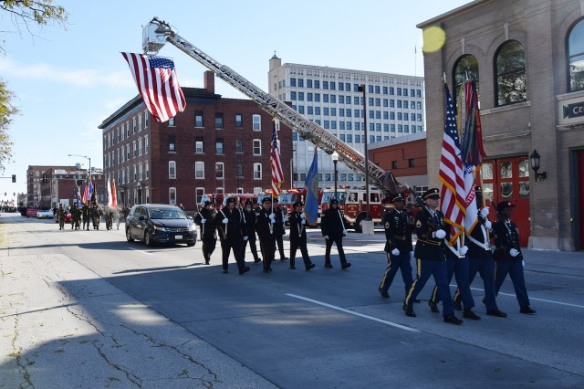 The U.S. Army Sustainment Command color guard leads the Davenport, Iowa, Veterans Day Parade Nov. 10.