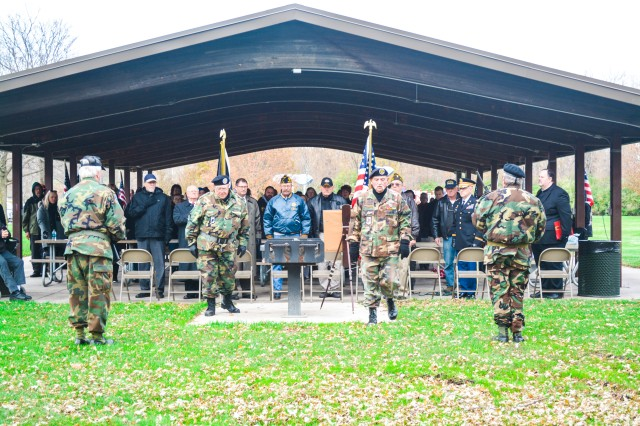 Honors are rendered during the posting of the colors adjacent to the Bettendorf Veterans Memorial, Nov. 11.