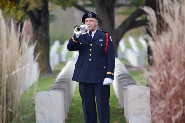 William Hall, from Bugles Across America, plays taps at the Veterans Day ceremony, at Rock Island National Cemetery, Nov. 11.