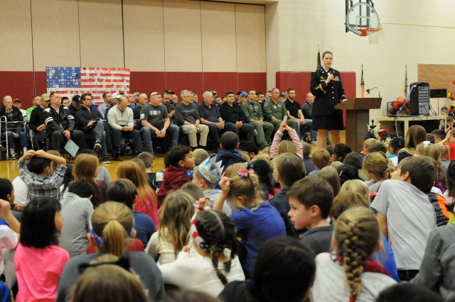 Maj. Rebecca Milkowski, executive officer, Distribution Management Center, ASC, was the keynote speaker at the Riverdale Heights Elementary School Veterans Day Commemoration, Nov. 10. Approximately 650 students, 50 staff members, and 50 veterans were in attendance at the event.