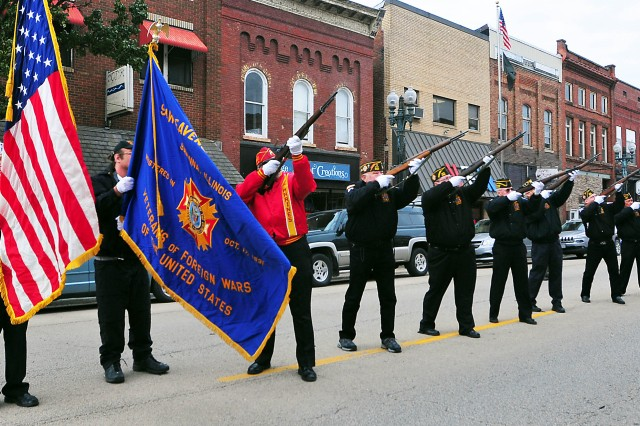 Members of VFW Post 2223 and American Legion Post 148 fire a rifle salute downtown Savanna, Illinois, Nov. 11, as part of the Veterans Day ceremony.
