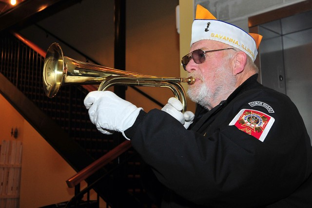 Bruce Mottin, senior vice commander, VFW Post 2223, plays taps during the Veterans Day ceremony in the Savanna, Illinois, Museum and Cultural Center Nov. 11.