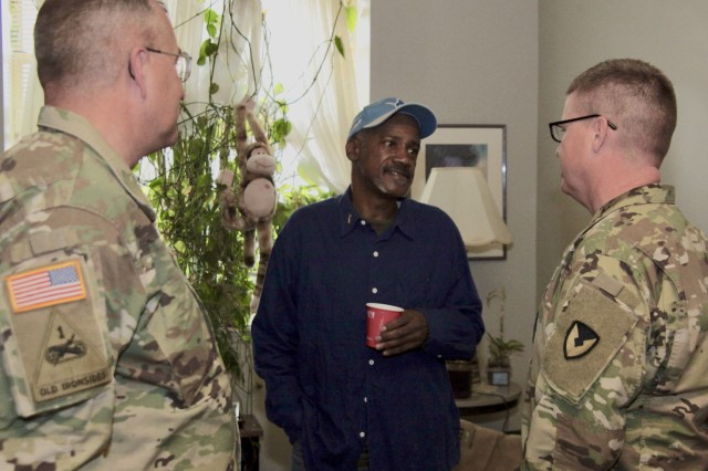 Maj. Gen. Clark LeMasters (left), commanding general of U.S. Army Tank-automotive and Armaments Command and Command Sgt. Maj. Ian Griffin toured Marcus Cobb's resident apartment at the Piquette Square for Veterans facility on Nov. 3, 2017.