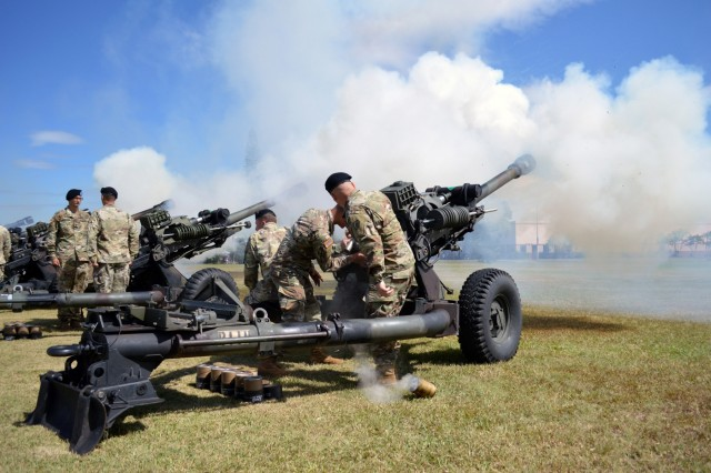 Cannon crewmembers assigned to 25th Division Artillery, 25th Infantry Division, fire their M119A3 howitzers for a 17-gun salute during the 25th ID pass and review to finish off Tropic Lightning Week at Schofield Barracks, Hawaii, on Oct. 5, 2017. Tropic Lightning Week is a weeklong sports event to commemorate the 76th anniversary of the division. (U.S. Army photo by Staff Sgt. Armando R. Limon, 3rd Brigade Combat Team, 25th Infantry Division)