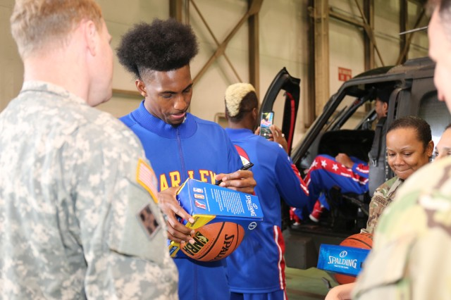 """Bull"" Bullard, members of TOHG, signs a basketball for a Soldier during TOHG's tour of the USAABJ hangar Nov. 9, 2017. (U.S. Army photo by Noriko Kudo)"
