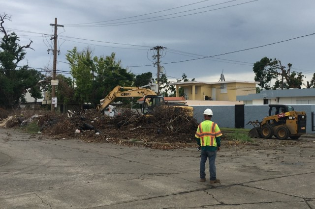 A U.S. Army Corps of Engineers contractor oversees curbside debris removal in Ponce, Puerto Rico. To date, more than 48 trucks have been used to haul 3,700 loads of debris created by Hurricane Maria from Ponce.