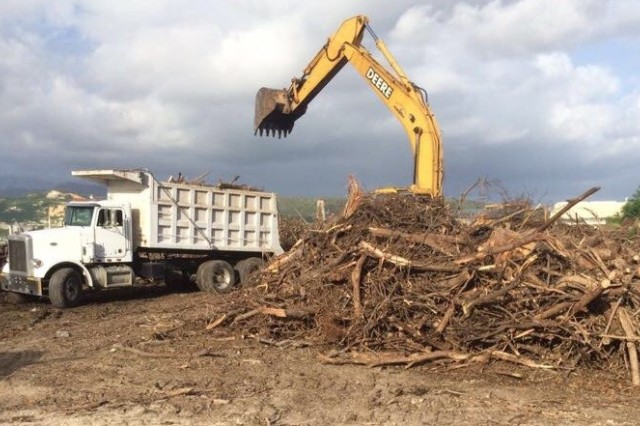 U.S. Army Corps of Engineers contractors removing Hurricane Maria debris from a temporary disposal site in Ponce, Puerto Rico. Approximately 630,000 cubic yards of vegetative debris will be reduced for composting and other uses. Construction and demolition debris such as lumber and household furniture is expected to yield about one million pounds of recyclable metals.