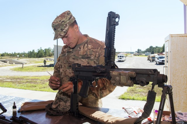 Sgt. Jordan Latham , a horizontal construction engineer assigned to the 161st Engineer Support Company, 27th Engineer Battalion, 20th Engineer Brigade cleans his weapon during the 2017 U.S. Army Forces Command (FORSCOM) Small Arms Marksmanship Competition on Fort Bragg, North Carolina. Soldiers from various units competed in the FORSCOM Small Arms Competition hosted by the 82nd Airborne Division.