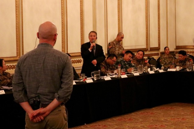 Mr. Steven Sobieszczyk, an earth scientist from the United States Geological Survey, briefs about flood forecasting to participants of the 13th iteration of the U.S. -  China disaster management exchange in Portland, Ore, Nov 13.  The annual United States Army Pacific (USARPAC) Security Cooperation event with the People's Liberation Army (PLA) is an opportunity to share lessons learned between USARPAC and the PLA in order to increase capacity to respond to natural disasters in the Pacific region. (U.S. Army Photo by Capt. John D. Howard Jr.)