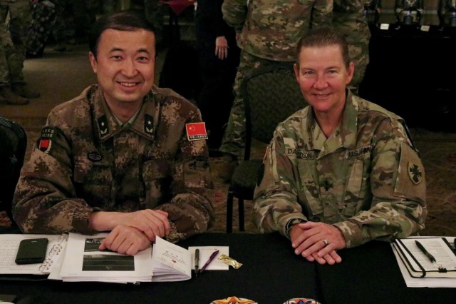 Major General Li Hui of the People's Liberation Army (PLA) and Maj. Gen. Susan A. Davidson, Commanding General of the 8th Theater Sustainment Command participate as the heads of delegation during the 13th iteration of the U.S. -  China disaster management exchange in Portland, Ore, Nov 13.  The annual United States Army Pacific (USARPAC) Security Cooperation event with the People's Liberation Army (PLA) is an opportunity to share lessons learned between USARPAC and the PLA in order to increase capacity to respond to natural disasters in the Pacific region. (U.S. Army Photo by Capt. John D. Howard Jr.)